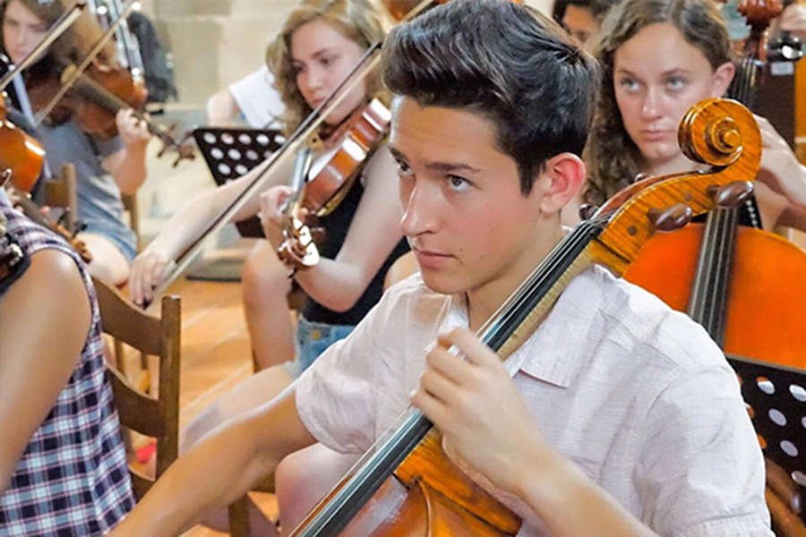 REHEARSALS FOR WORLD STAGE. Senior Giacomo Glotzer plays with the Chicago Youth Symphony Orchestra in the Czech Reupublic this summer. After months of rehearsing, he traveled to three European countries with the orchestra.