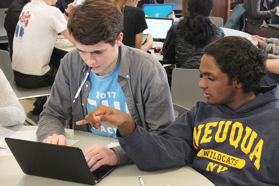 COMPUTER FUN. Junior Campbell Phalen and Rohan Sugden, a junior from Neuqua Valley High School, work together on a computer science problem at ProCom 4.0, a programming competition hosted at U-High March 3. Students worked together on code, but awards were granted to each school. Neuqua Valley students earned first place.