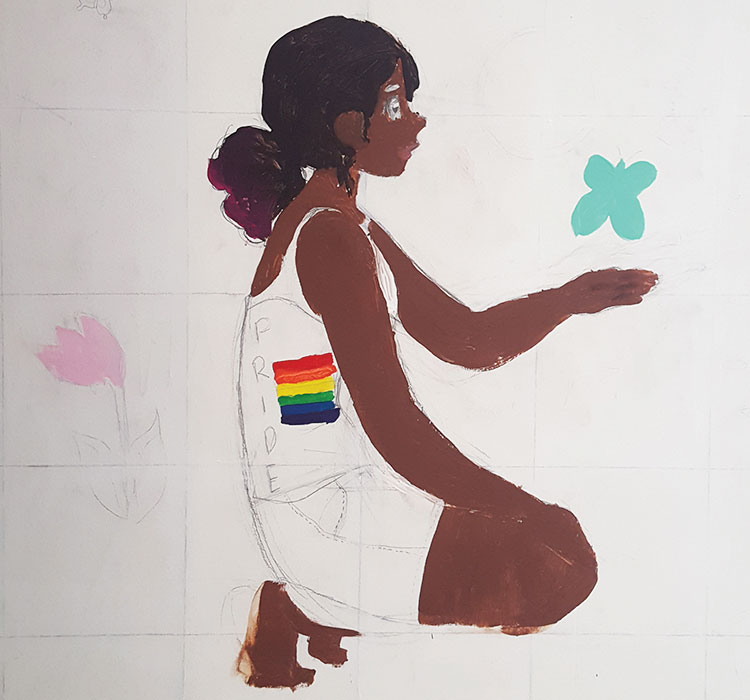 THE REPAIRED MURAL. A student wrote a homophobic slur on the LGBTQ rainbow flag. The slur has since been covered.
