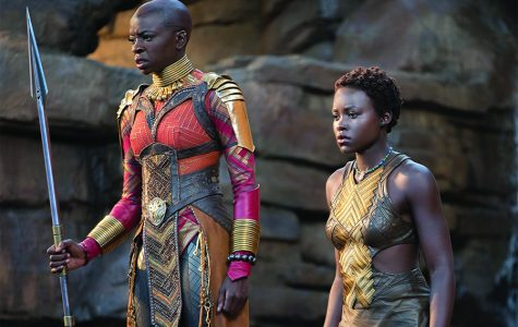"""STANDING STRONG. Two of the strong female characters stand together before a fight scene. People have been drawn to """"Black Panther"""" for its non-traditional portrayal of both  African-Americans and women."""