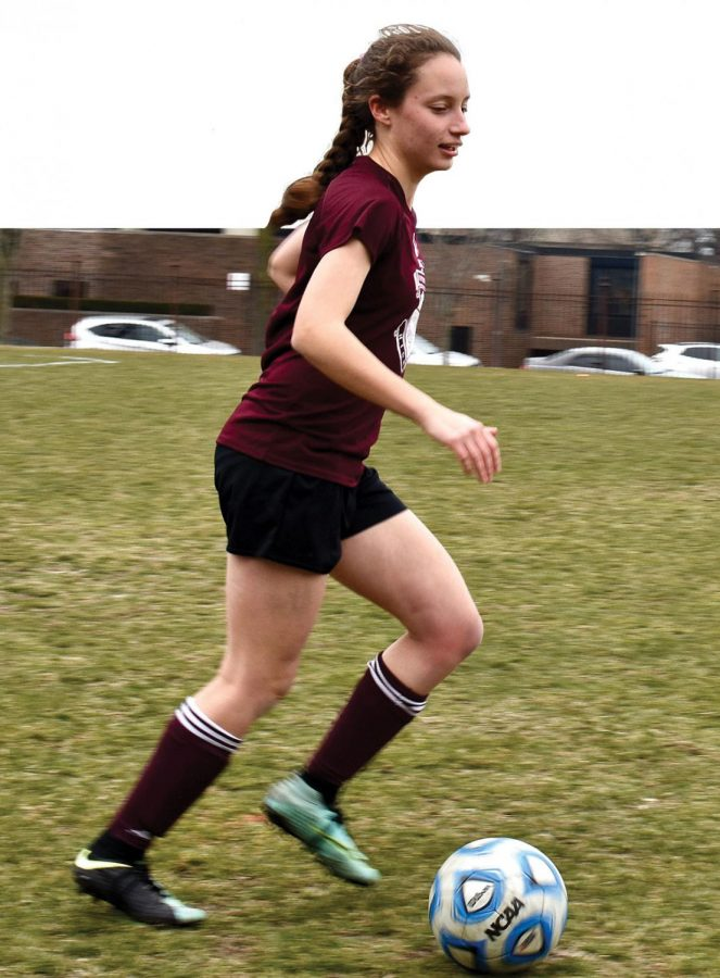 SOCCER STAR.  Captain Anna Kenig-Ziesler dribbles a ball down Jackman Field during practice. In her fourth year as a varsity girls soccer player, Anna has high hopes for a strong showing at state, with the chance to win U-High's first state title.