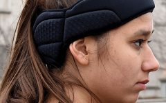 Despite complaints, soccer head guards now in use