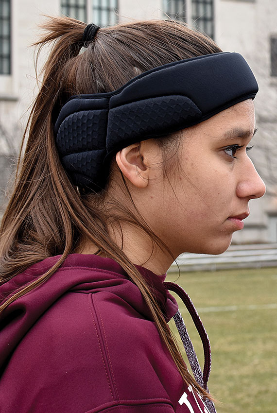 HEADS-UP. Senior varsity soccer player Isabella Light wears a mandatory concussion head guard at a practice.