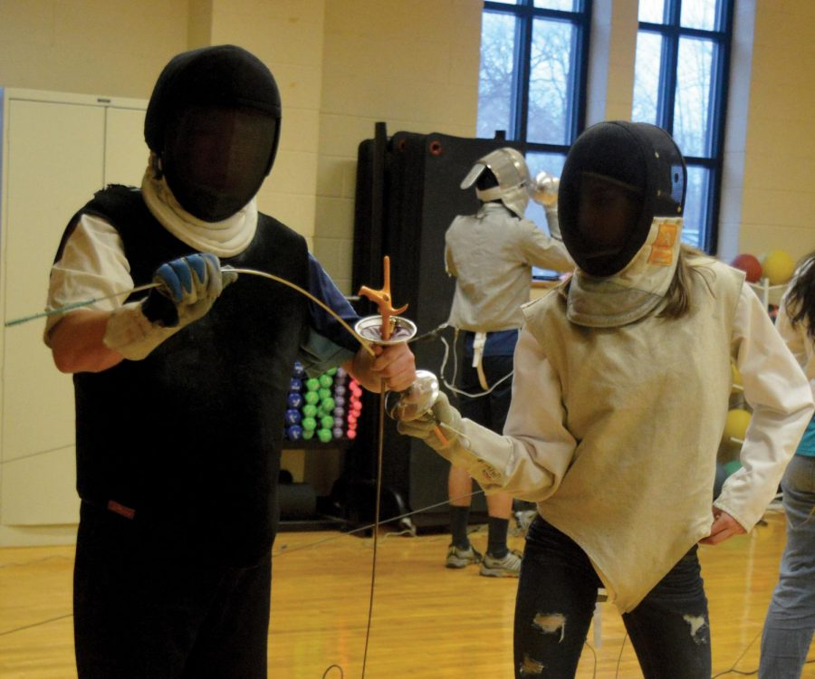 BEND, DON'T BREAK. Head coach Bakhyt Abdikulov works with a fencer at an afternoon practice. Mr. Abdikulov has been coaching for nearly 25 years, internationally and in the United States.