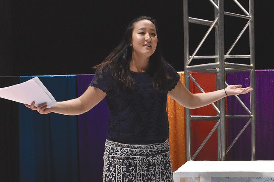 MAGIC IN THE MAKING. Senior Nicole Horio, who plays the Leading Player, and junior Jacob Beiser, who plays Pippin, rehearse a scene from spring production of