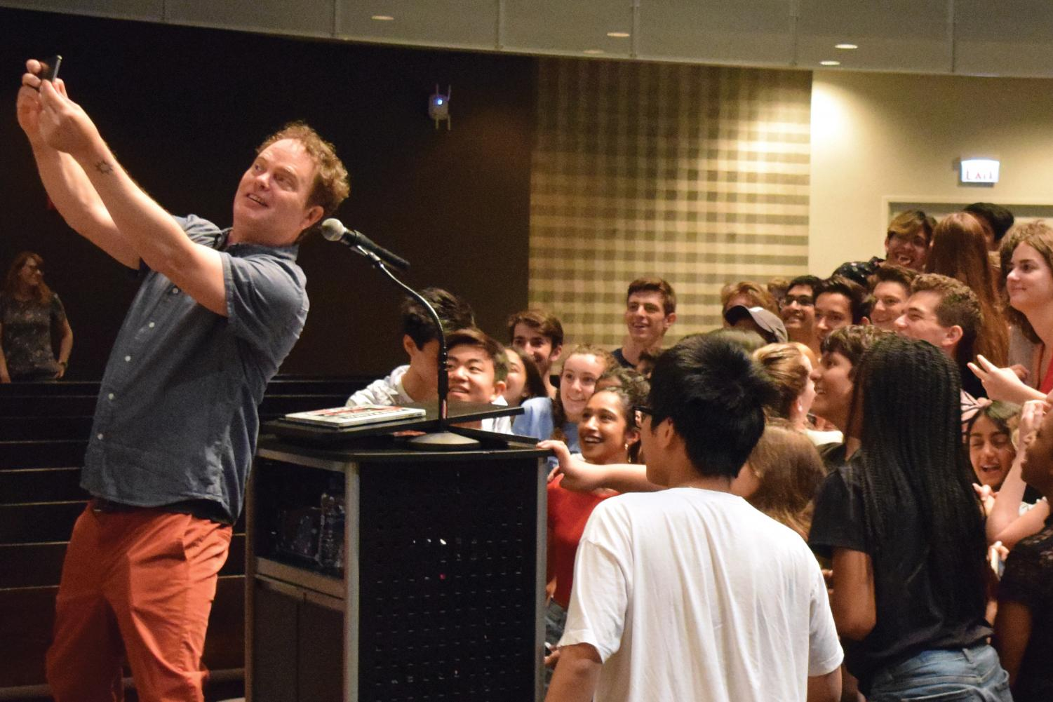 "SUPER SELFIE. Rainn Wilson, an actor known for his role as Dwight Schrute in ""The Office,"" takes a selfie with U-High students who attended the optional assembly May 24. Wilson spoke about his production company, SoulPancake, and its role in his efforts to change the world."