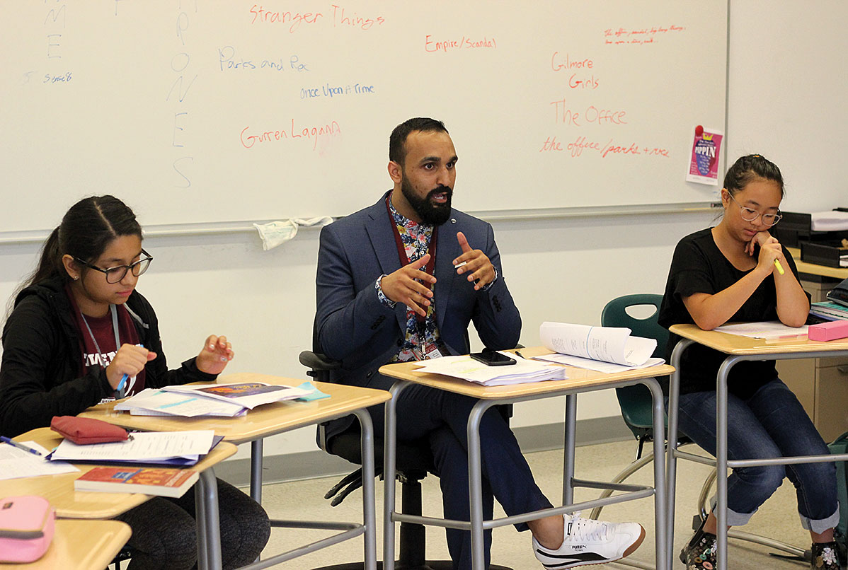 LITERARY LEARNING. New English teacher Hasham Bhatti speaks to a freshman class. This year's new faculty members represent more people of color than in past years.