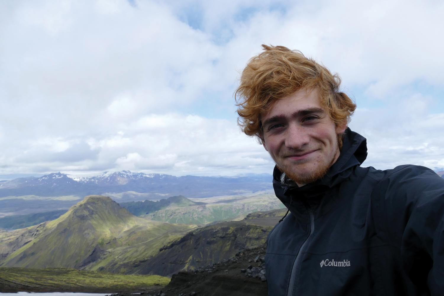 mountain man. Wind whipping through his hair, senior Reuben Slade takes a selfie on a mountain in Iceland, where he went on a five-day solo hike during summer break.