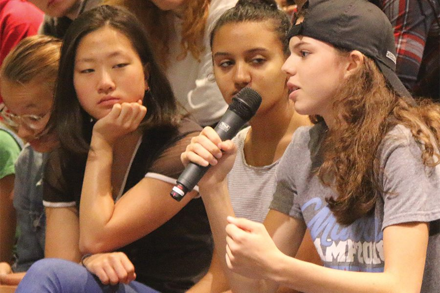 TUESDAY CHECK-IN. In a morning assembly on Oct. 9, junior Mary Neal offers her perspective in a discussion on the Van Dyke trial and Kavanaugh confirmation. Classes were cancelled during first period as each grade level met.
