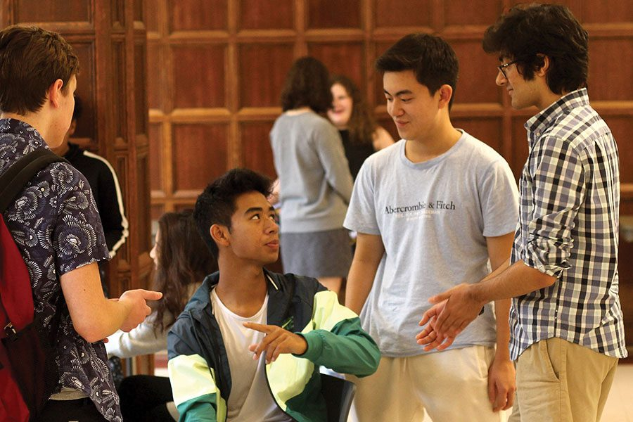 MENTORING NEWBIES. Sophomores Danny Han, Marcus Chang and Adi Badlani speak to a Danny's mentee about his transition to high school. They met during a lunch in Judd Hall as part of the new mentorship program to help freshmen adjust to life at U-High.
