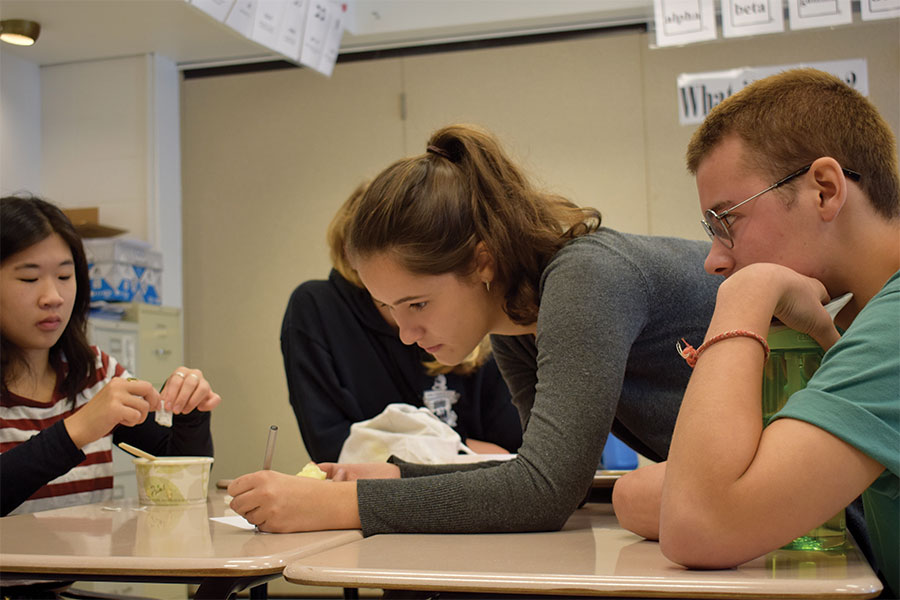 FOSTERING DISCUSSION. Izzy Knowles, Michael Harper, and Addy Maciak, seniors, talk during a meeting of Feminist Club. Sally Carlstrom, a senior, and one of the leaders of the club, often worries that if a point she found offensive was brought up in a club discussion, she might not respond in the way she would like to. Respectful disagreement is a cornerstone of Feminist Club.