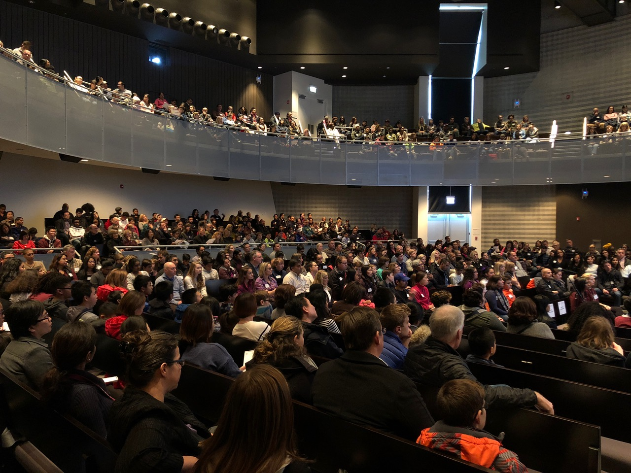LEARNING ABOUT LAB. Prospective families and students fill the ground floor and most of the balcony in the Gordon Parks Assembly Hall during the Admissions Open House Oct. 27. They listened to presentations about Lab's curriculum and its resources for students.