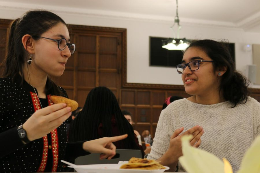 Sophomores Ela Chintagunta and Manou Chakravorty celebrate Diwali, the Hindu festival of lights, with food and decorations provided by ASA.