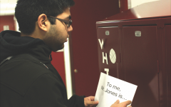 "SUPPORTING FORMER FACULTY. Senior Sohil Manek hangs a poster to support science teacher Daniel Bobo-Jones, who was terminated Jan. 8. Alex Stevanovich, a senior who helped organize the show of support, said, ""I wanted to say, 'Hey Mr. Jones, we appreciate you.'"""