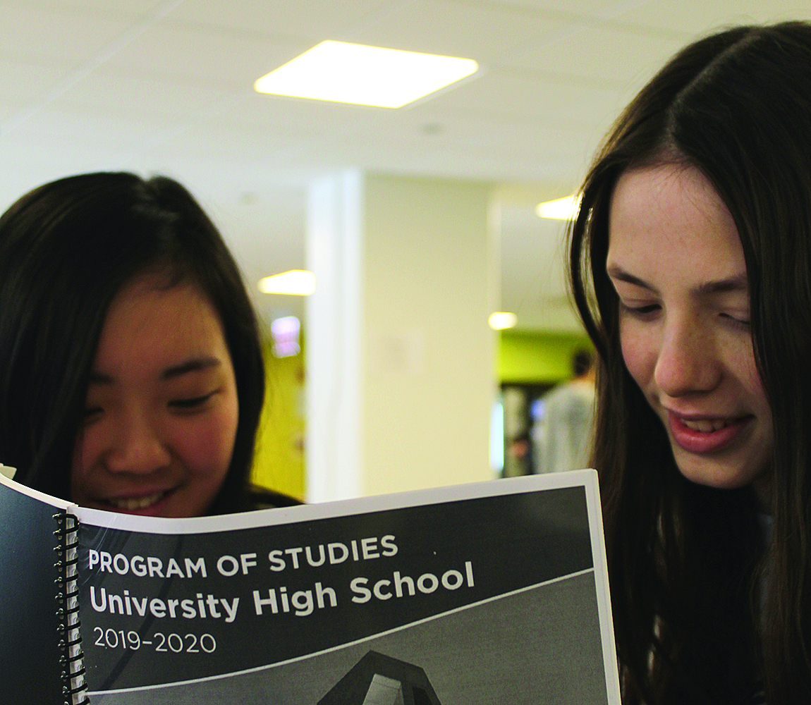 SELECTING STUDIES. Emily Chang and Isabel Randall look over the 2019-20 Program of Studies. Students have the opportunity to choose a few new semester-long courses.