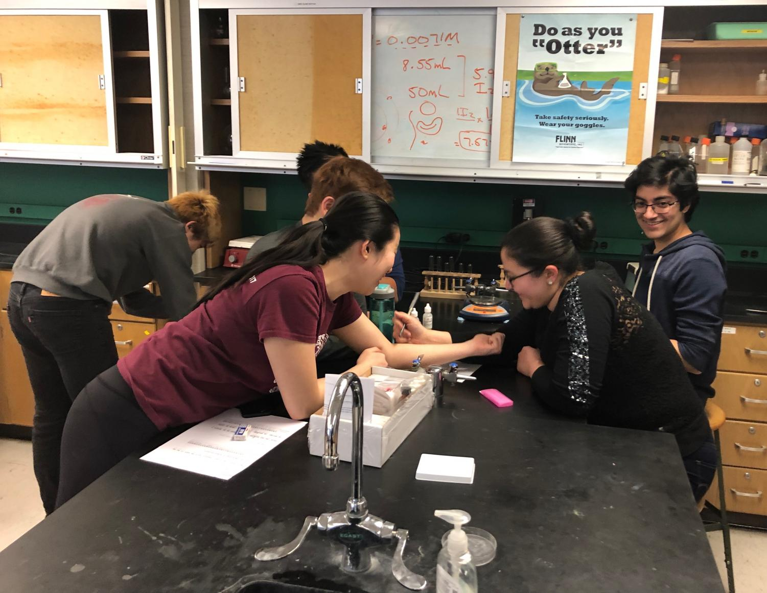 Members of the U-High Science Team prepare for the next competition.
