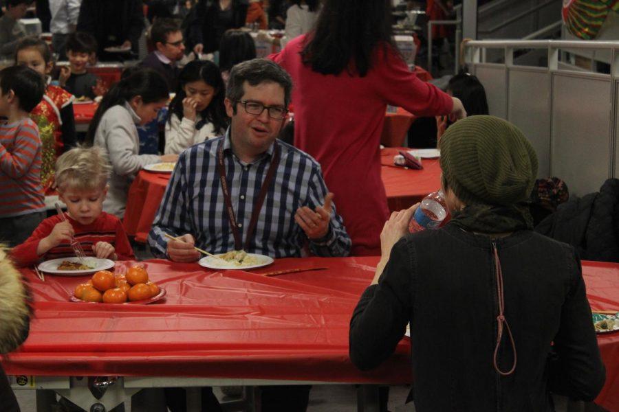 Colin+Rennert-May%2C+English+teacher%2C+talks+to+Sunny+Neater%2C+art+teacher%2C+during+the+Lunar+New+Year+Dinner+Feb.+7.