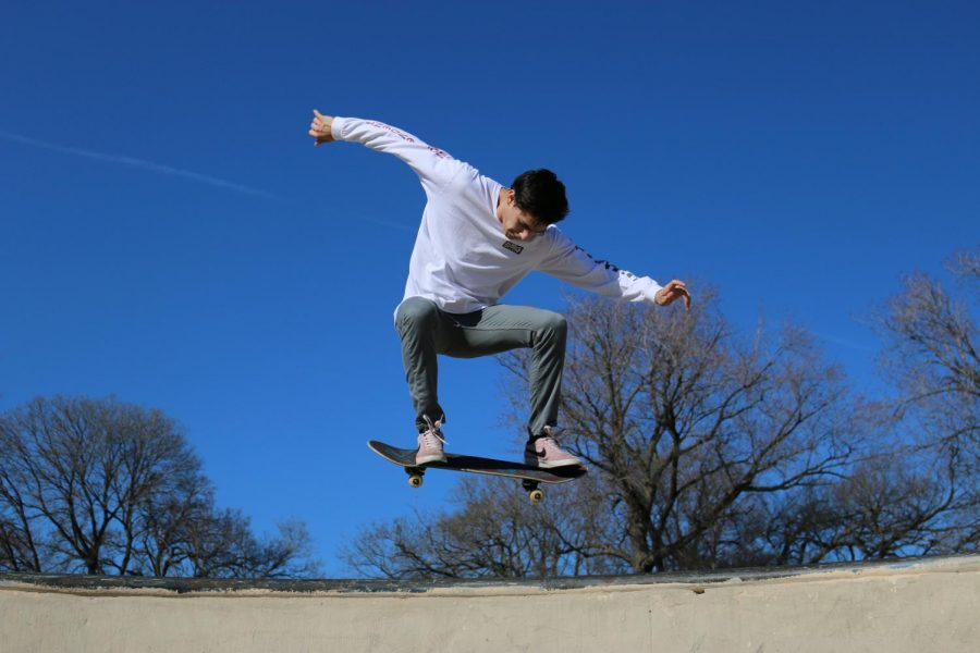 TRICKS BY THE LAKE.  Practicing a jump at one of his favorite skating parks, Burnham Skating Park  alongside Lake Shore Drive, junior Sebastian Ingersoll gets some air April 15. When Sebastian first started skating the summer before his freshman year, it was something fun to do with friends and his older brother. Last fall, most of his friends started to lose interest but Sebastian still tried to get out on his board as much as possible, even if he was alone. Sebastian explained that with his hectic gymnastics schedule it's difficult to set aside time to go out skateboarding. He also said he wants to push himself to try new things while skateboarding, but doesn't want to hurt himself and risk his ability to compete in gymnastics.