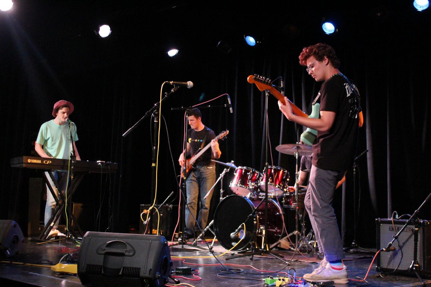 Seniors Sam DuBose, Henry Cassel, Grant Fishman (not pictured) and Michael Harper perform on stage for Lab's 'Electric Gordyland' performance. A student-led show, it serves as the culminating project of Mr. Francisco Dean's