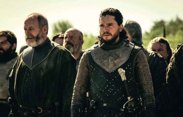 FINAL+MOMENTS.+Ser+Davos+Seaworth+%28Liam+Cunningham%29+and+Jon+Snow+%28Kit+Harrington%29+look+upon+the+battle+eld+with+their+army+at+their+back.+Both+characters+have+been+in+the+%E2%80%9CGame+of+Thrones%E2%80%9D+series+since+its+first+season.+The+cultural+phenomenon%E2%80%99s+eighth+and+final+season+concludes+May+19.
