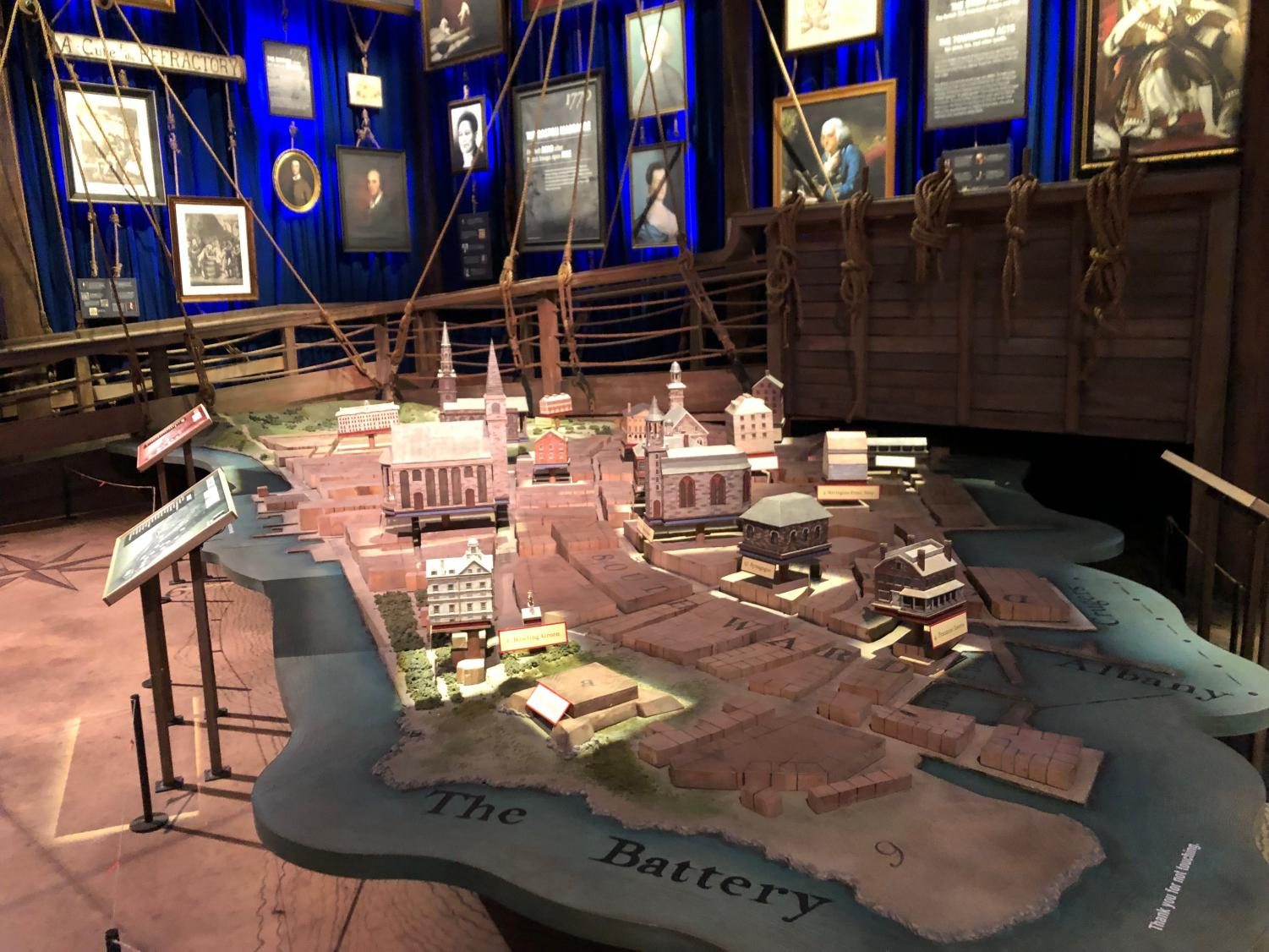 """HAMILTON'S WORLD. This diagram of """"The Battery,"""" a term for Manhattan based on the artillery batteries that protected the city from the British, comes complete with sets of buildings that defined New York at the time. The room is decorated with portraits of important figures in Hamilton's life."""
