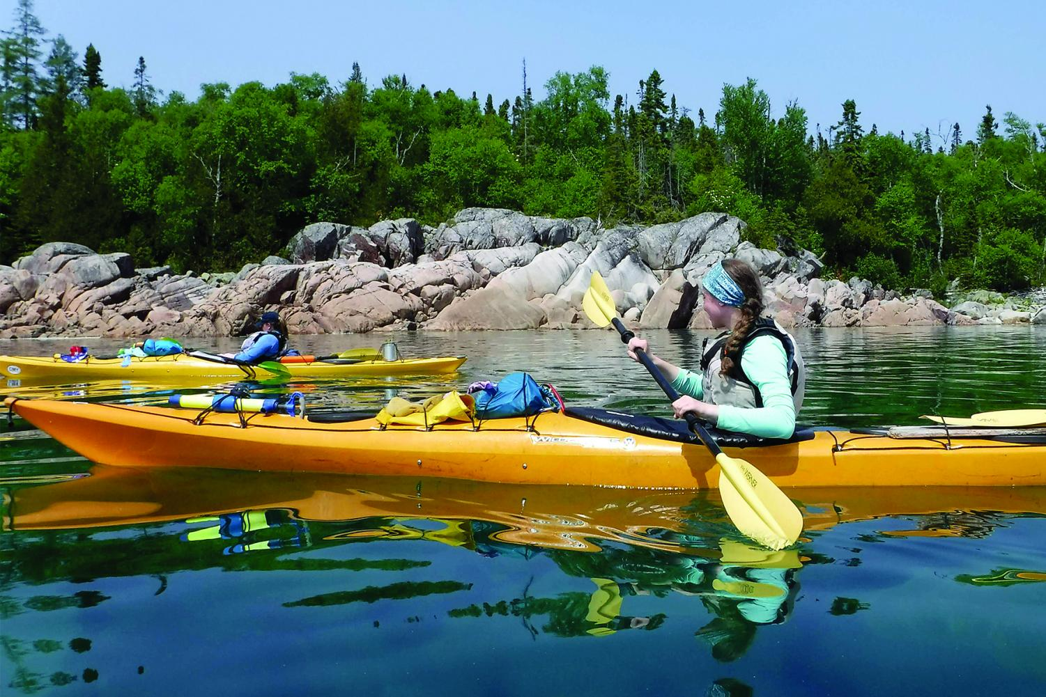 KAYAKING KAUFMAN. Junior Izzy Kaufman-Sites kayaks on Lake Superior on her 25-day sea kayaking trip this summer. The trip was through YMCA Camp Manito-Wish and she traveled 310 miles in Ontario from Agawa Bay to Silver Inlet.