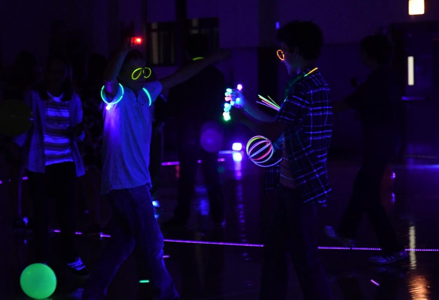 GLOW UP. A group of students dance in Upper Kovler Gym, where the Homecoming dance took place Saturday, Sept. 28.