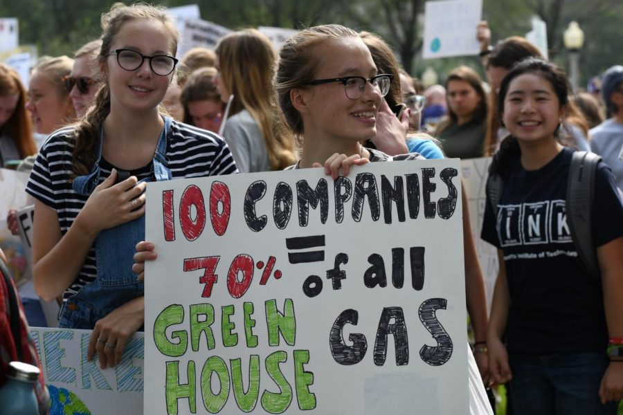 CLIMATE CRISIS. Senior Franzi Wild arrives in Grant Park with her sign on display.