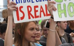 CHANTING FOR CHANGE. U-High senior Joana Rose and other students walk out to protest in the Global Climate Strike on Sept. 20.