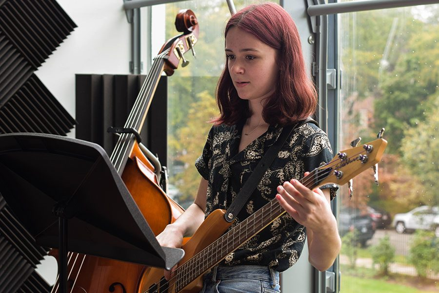 """ALL ABOUT THAT BASS. Emelia Piane, who released a single, """"Shrine,"""" this summer, practices her electric bass. Emelia played bass with student band Rooftop Parking."""