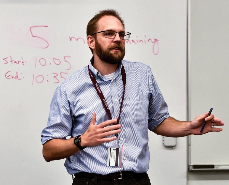 LIFE LESSONS. Standing in front of a white board, Humanities teacher Sam Nekrosius gives a demonstration to his seventh-period class. Combining English and History, The course encourages students to place their own identities in the context of American social justice.