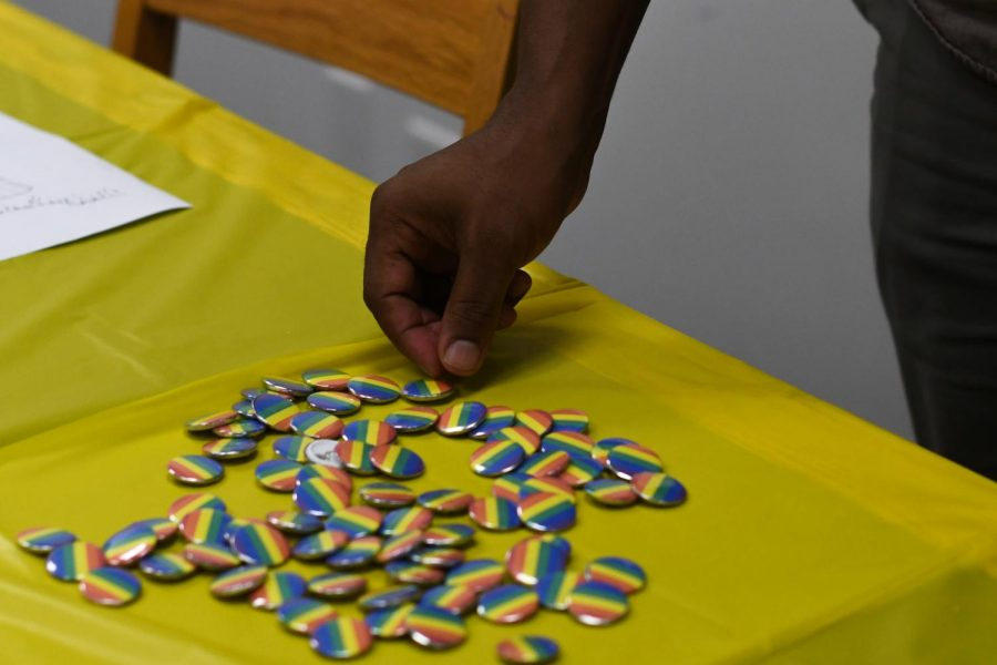 Buttons, handmade by a member of the middle-school affinity group Prism, were available at a celebration for National Coming Out Day Oct. 10.