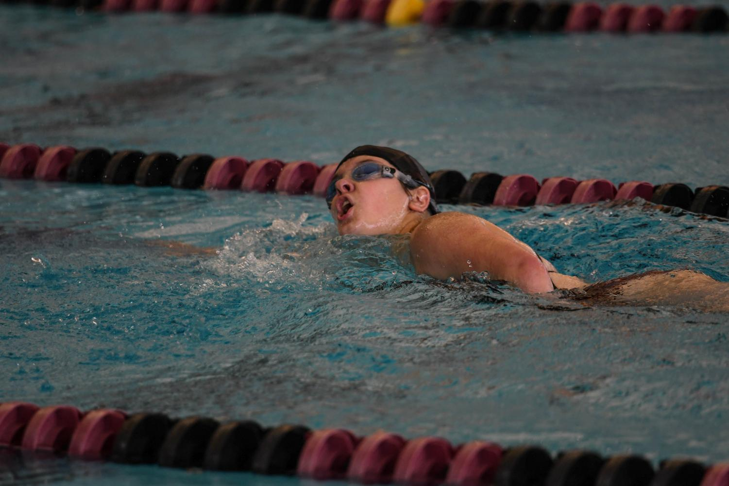 Junior Jayne Crouthamel swims during earlier October 5 meet, a dive to save lives fundraiser. Jayne qualified for State in the Athletes with Disabilities 50 and 100 Yard Freestyle events.