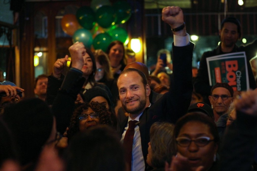 Chesa Boudin at his campaign's headquarters in San Francisco celebrates his victory with a group of his supporters.
