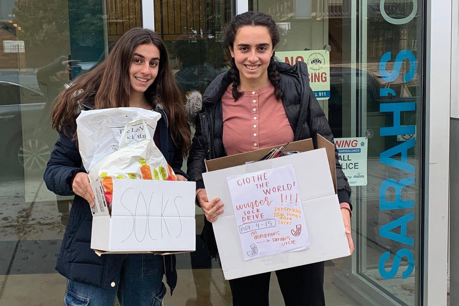 SERVICE SUPERSTARS. Sisters Adrianna and Alexandra Nehme drop sock donations from U-High club Clothe the World at Sarah's Circle, a nonprofit that supports women in need in Chicago.