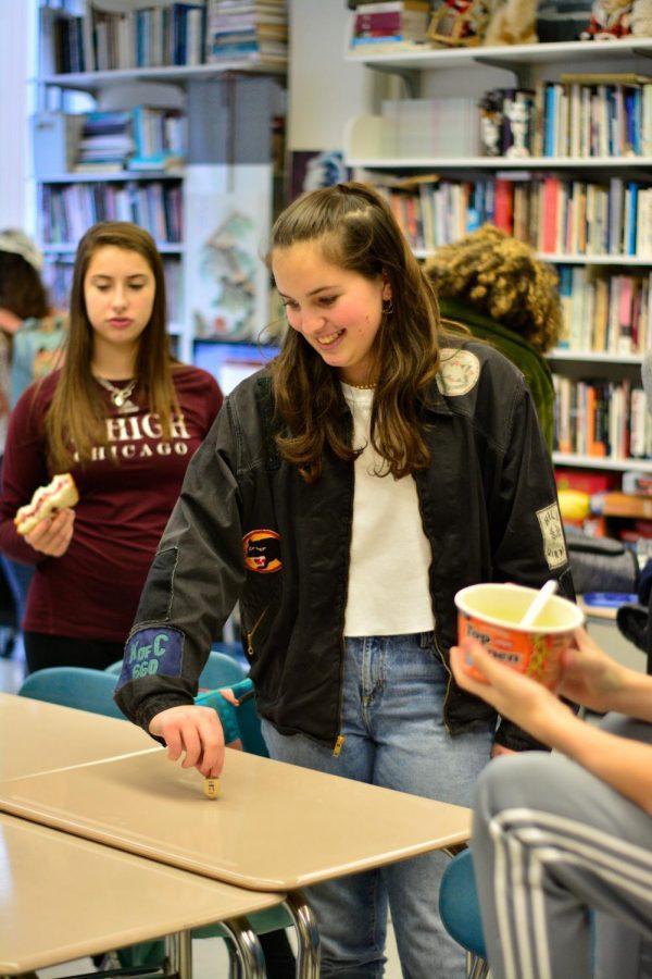 Sophomore Natalie Hultquist spins a dreidel at the Jewish Students Association's Hanukkah celebration Dec. 13.