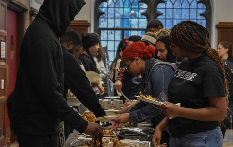 Students pile plates with food from the potluck-style Blacksgiving spread Nov. 21 in Judd C116. Many clubs had similar events planned for the spring, which now have to be reworked to take place remotely.