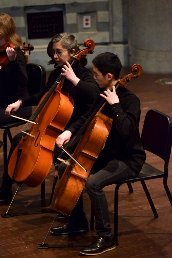 """Sophomore Aaron Kim and music teacher Michelle Morales of the Chamber Collective play the cello at the Martin Luther King Jr. assembly Feb. 16. They played """"At the Purchaser's Option"""" by Rhiannon Giddens. Later in the assembly, the Concert Choir performed """"Rise up"""" with soloists Jasmine Tan and Clare O'Connor."""