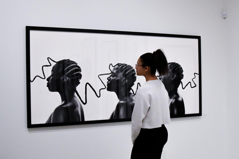 Lusia Austen examines one of the photos of the exhibit