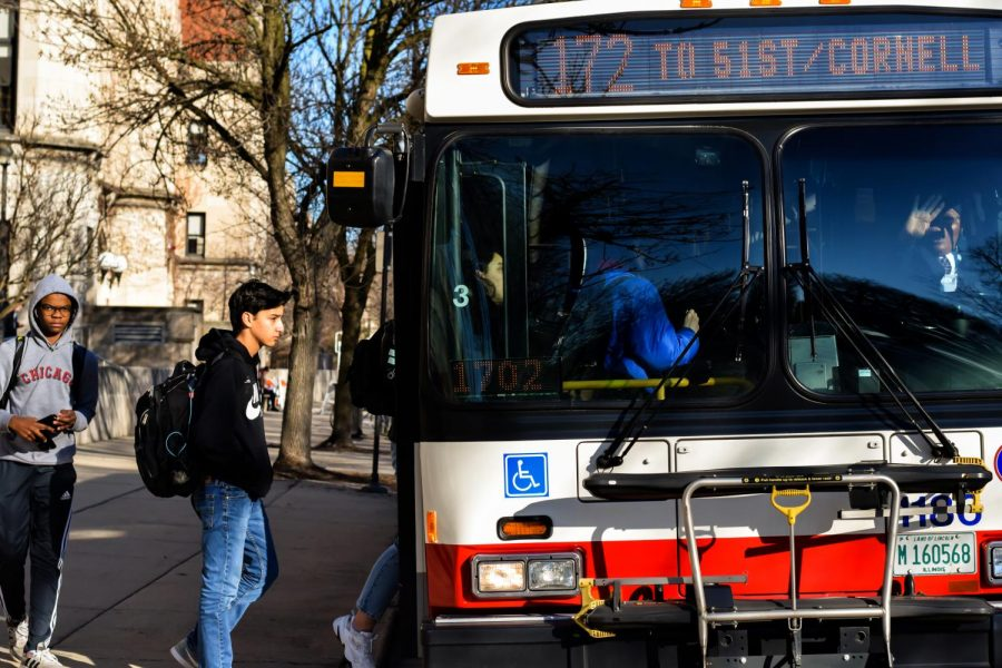 ALL ABOARD. Sophomores Ben Ruiz and Amelia Sharma board the 172 CTA bus to 51st Street and Cornell Avenue after school. Many students commute with at least one mode of public transit.