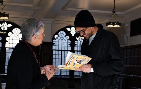 BEST BOOK. 2009 U-High graduate and author Gabriel Bump talks to English teacher Catie Bell as he signs his book