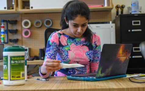 Rashne Hassan scrutinizes a recently-printed car of the kind she hopes to be building with the club she is creating, where students would participate in F1 in Schools, a competition where students build small cars and race them against other schools.