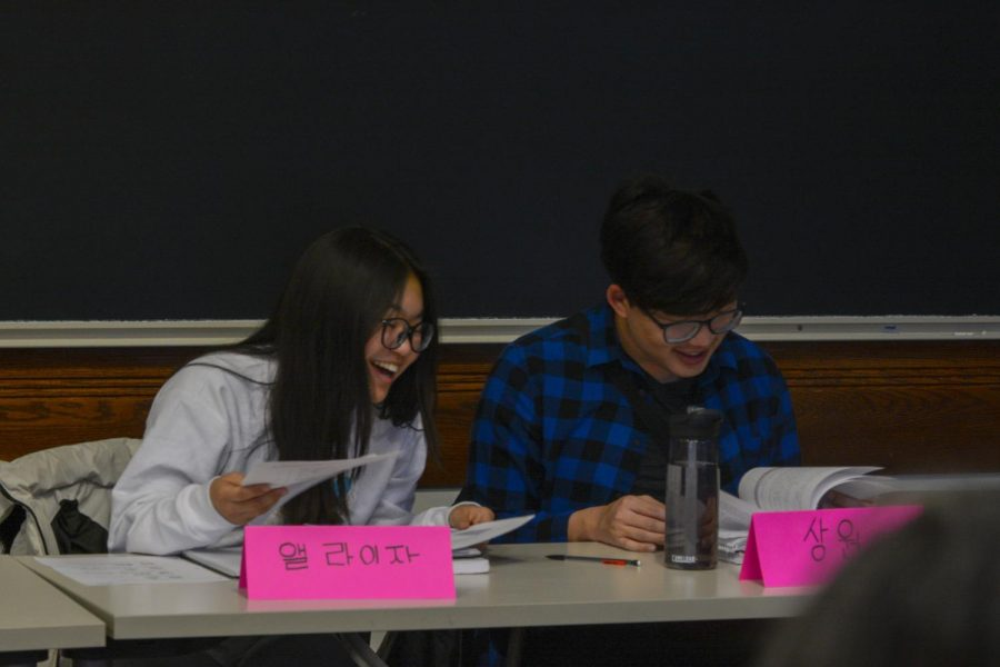 LEARNING BY SPEAKING. Eliza Doss works with 2019 U-High graduate Ryan Lee in a Korean class at the University of Chicago. Students attend the class five days a week to learn their heritage language.