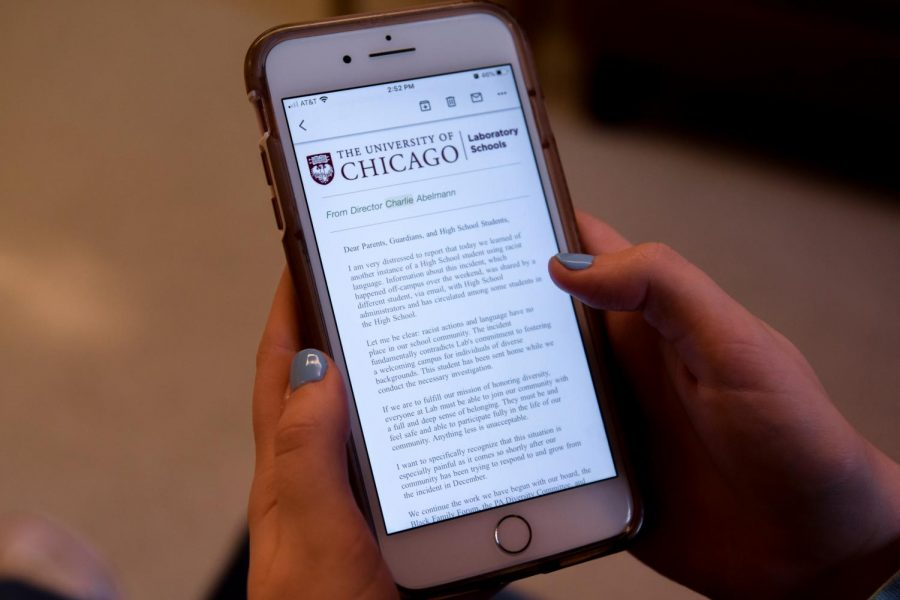 A student reads the email from Laboratory Schools Director Charlie Abelmann.