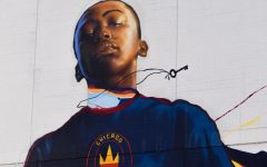 """STAND FOR CHICAGO. An 80-foot tall mural looms over the British International School soccer field in the South Loop on the back of the Roosevelt Collection. The artist, Max Sansing, sought to """"represent Chicago youth"""" with his artwork. According to the Fire, the mural will stay up for at least three years."""