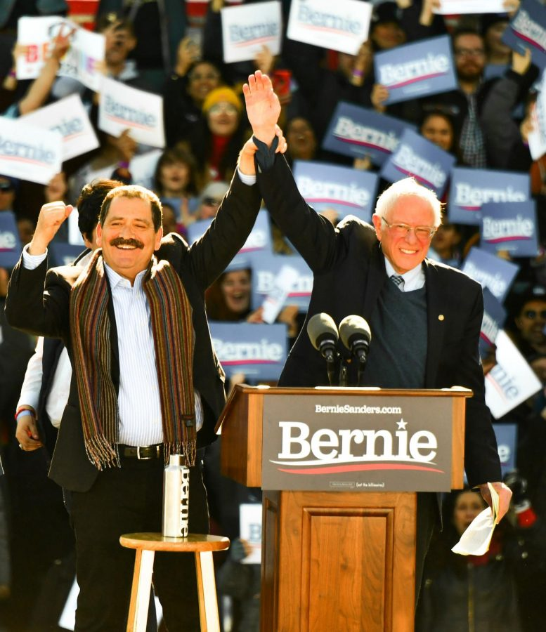 """SUPPORTING SANDERS. Ahead of the Illinois Democratic Primary on March 17, U.S. Rep. Jesús """"Chuy"""" Garcia of Chicago stands with Sen. Bernie Sanders before thousands of supporters on March 7 at the Petrillo Music Shell in Grant Park. Sen. Sanders  spoke about issues important to his campaign such as Medicare for All, racial injustice, income and gender inequality"""