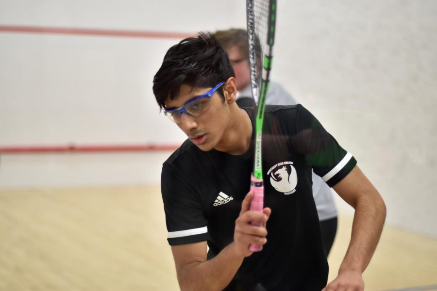 Gaurav Shekhawat, co-captain of the squash team, plays in a game against Lake Forest Academy on Jan. 30. Gaurav and six others on the team participated at the USA Squash National Championships on Feb. 22 in Hartford, Connecticut.