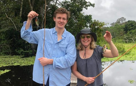 """Senior Nick Beach and Sally Beach, mother, fish piranhas in Iquitos, Peru. """"Instead of doing it and having fun, in the back of your mind you're always thinking of what's next, what are we gonna do?"""" Nick said regarding his four-day stay in the Peruvian Amazon."""