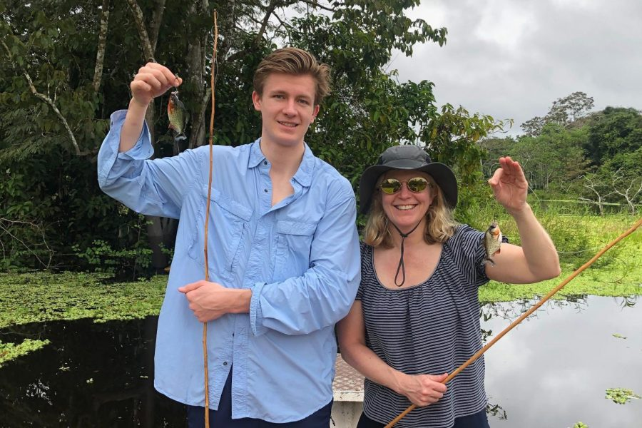 "Senior Nick Beach and Sally Beach, mother, fish piranhas in Iquitos, Peru. ""Instead of doing it and having fun, in the back of your mind you're always thinking of what's next, what are we gonna do?"" Nick said regarding his four-day stay in the Peruvian Amazon."