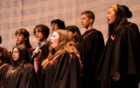 Ninth-grader Clare O'Connor sings a solo for a choir performance at the 2020 Martin Luther King Jr. Assembly. While many simply use choir to fulfill the music requirement for graduation, some continue into Bel Canto or other music classes afterward.